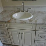 This vanity with a drop in sink is of Australe Dream marble