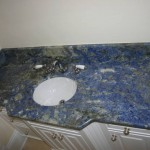 A Blue Sodalite granite vanity top with an undermount sink