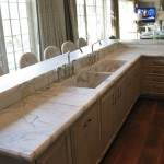 Calacatta Gold 5cm raised bar and sink counters with a custom edge profile.