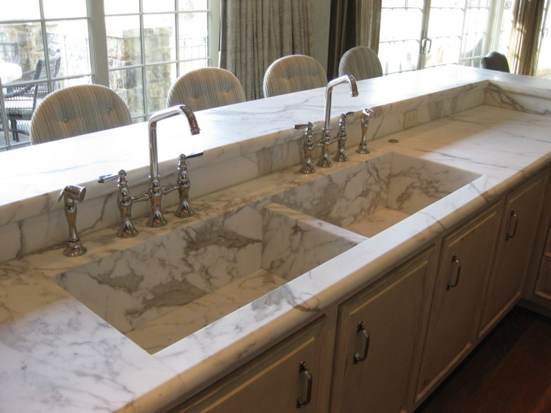 These Calacatta Gold sinks were custom fabricated to match the counters.