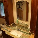 Esmeralda Onyx Vanity with an undermount sink; onyx bases under the tower cabinets and onyx backsplash