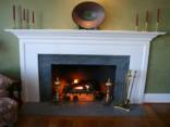 A Soapstone fireplace hearth and surround