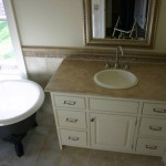 A honed Suede travertine vanity with a drop in sink.