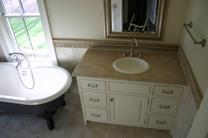 A Honed Suede Travertine Vanity With Drop In Sink
