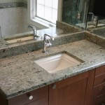 This vanity with an undermount sink is of Vermont Apple Green granite. The granite is extremely interesting in that it looks like it is made up of hundreds of fossilized shells.